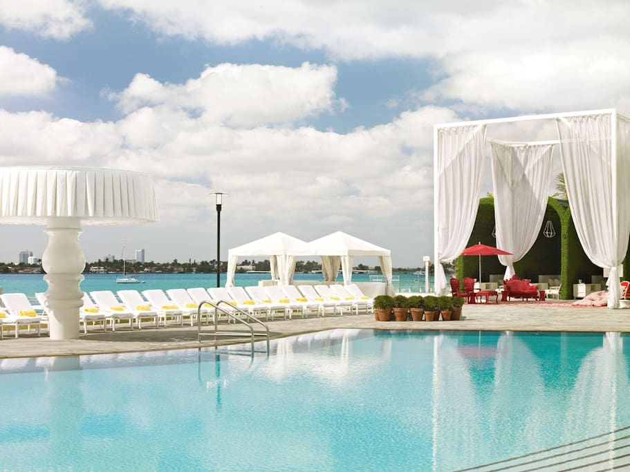 Relax next to the pool in a private cabana