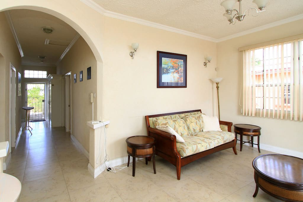 Living room and hall leading to garden.