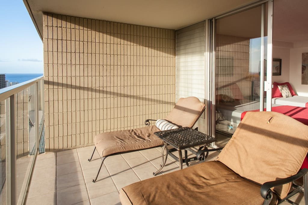 Balcony with chaise lounge chairs
