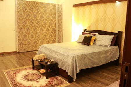 Our house is located in the posh are of Lahore with peaceful and lush green locality. It is the most secure place to live specially for foreigners. We offer amazing hospitality with comfortable accommodation. Not to be missed