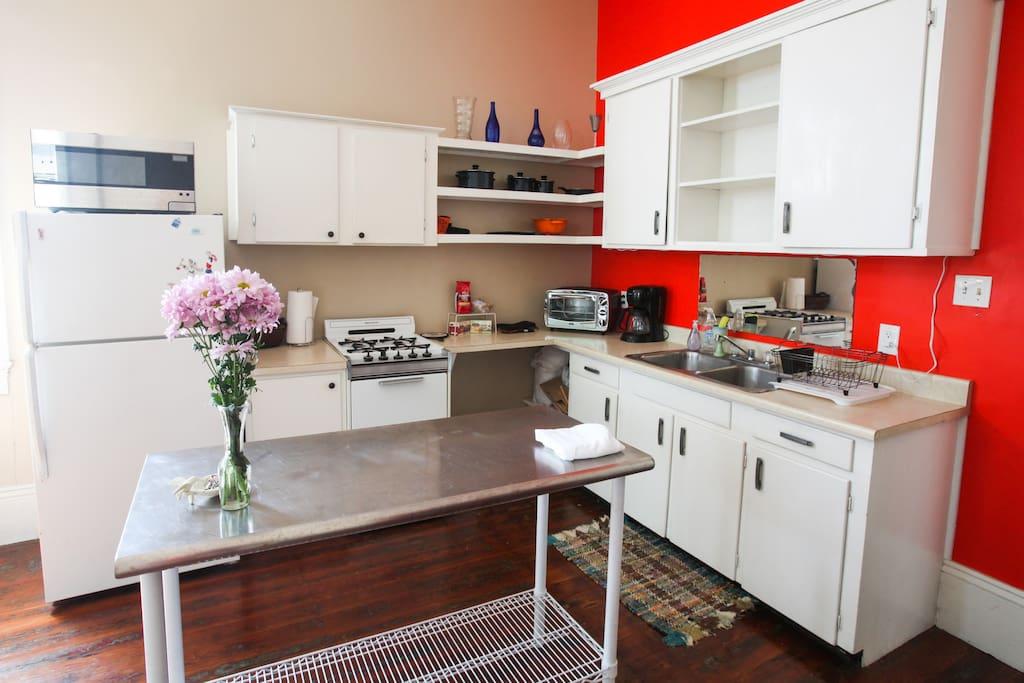 Nice light, gas stove, toaster oven, coffee pot, fridge, and microwave.