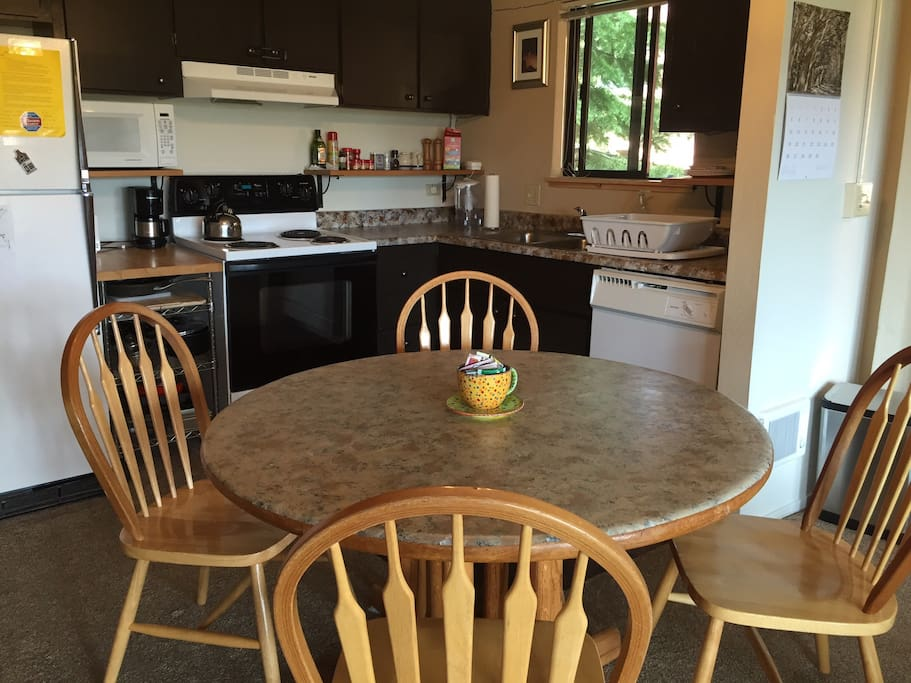 Kitchen and dining area. Fully equipped kitchen with range/oven, dishwasher, full fridge and cookware etc.