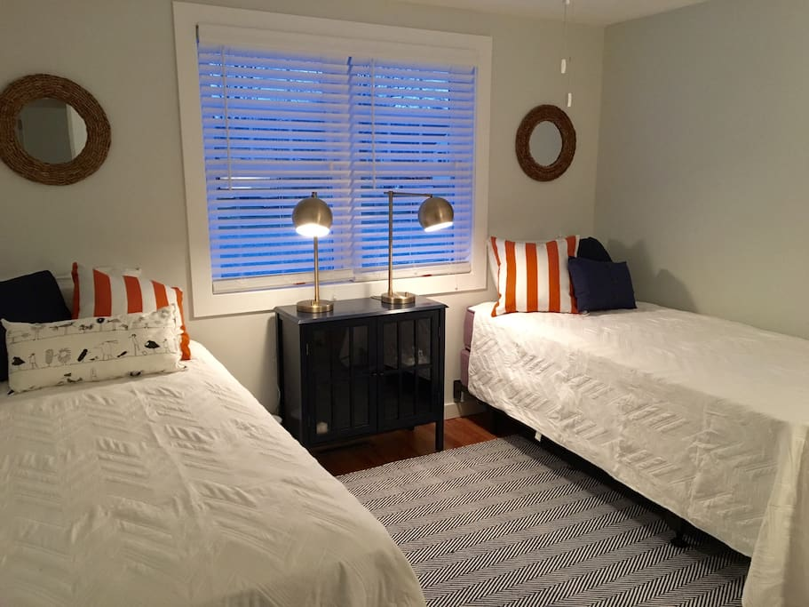 The front bedroom contains two xl long twin beds that can convert to a king.