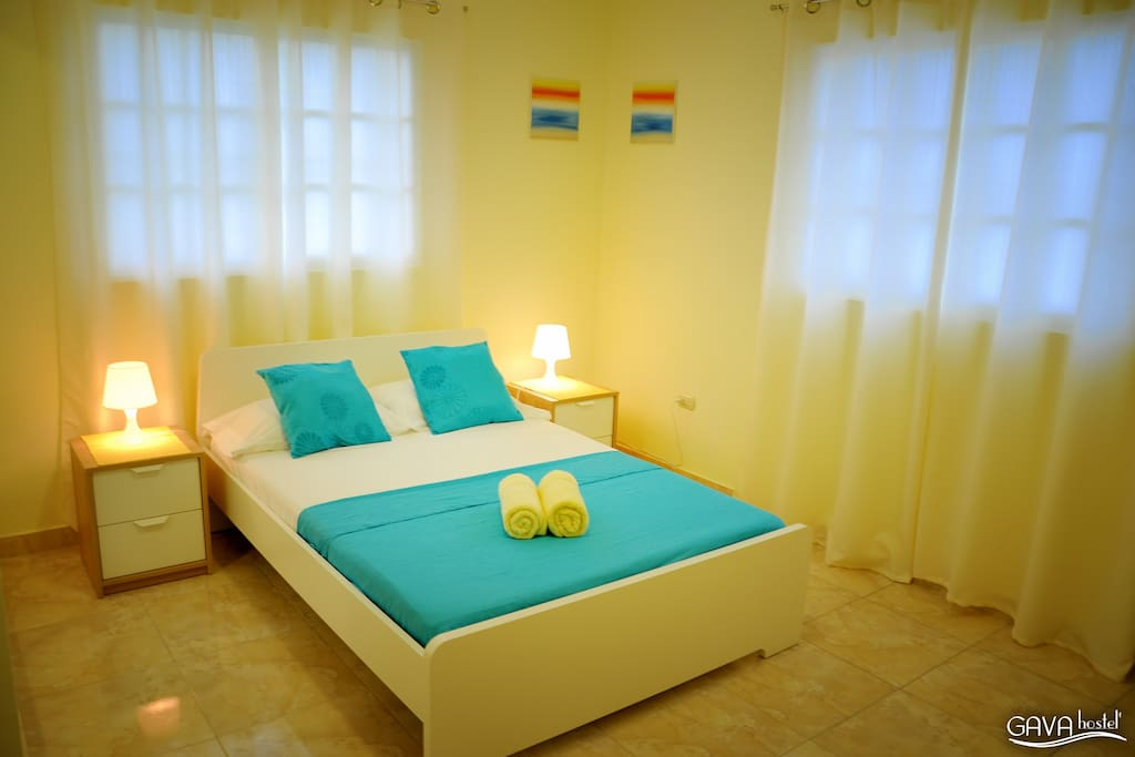 Private double room standard with queen sized bed and suite bathroom.
