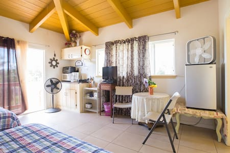 This private & clean studio is located near Kehena Black Sand Beach. It is on the side of large home & has a private entrance .  Our studio is an expensive way to stay in Hawaii while being provided w/ the amenities that you need (Wi-Fi, ph., TV).