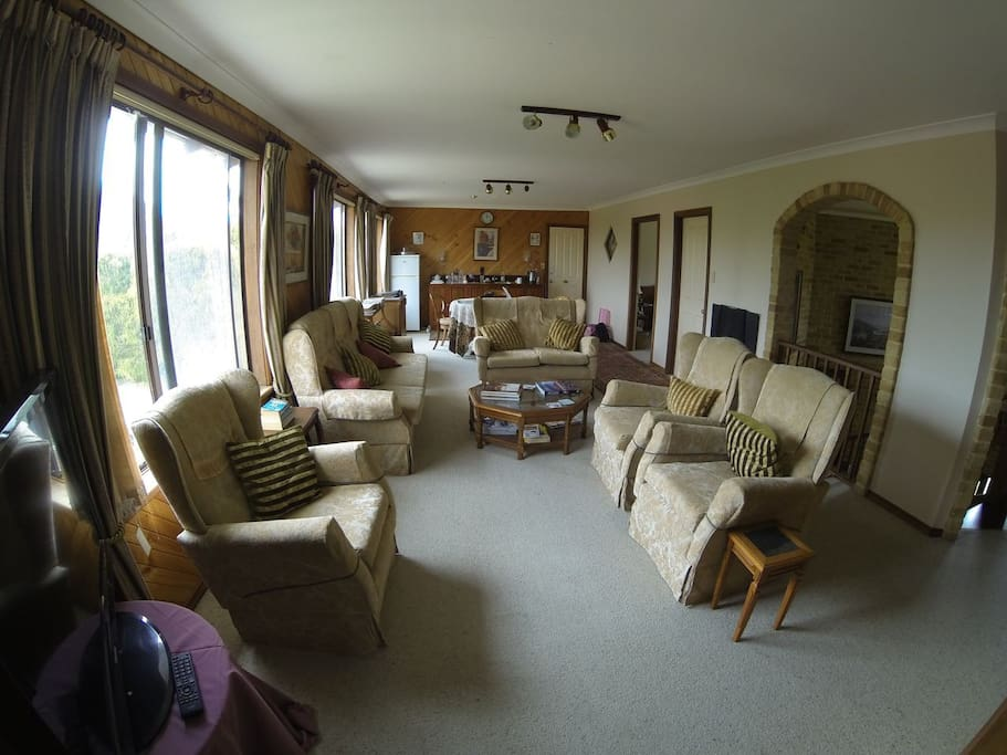 Guest lounge with big screen TV, fridge, microwave and tea and coffee making facilities.