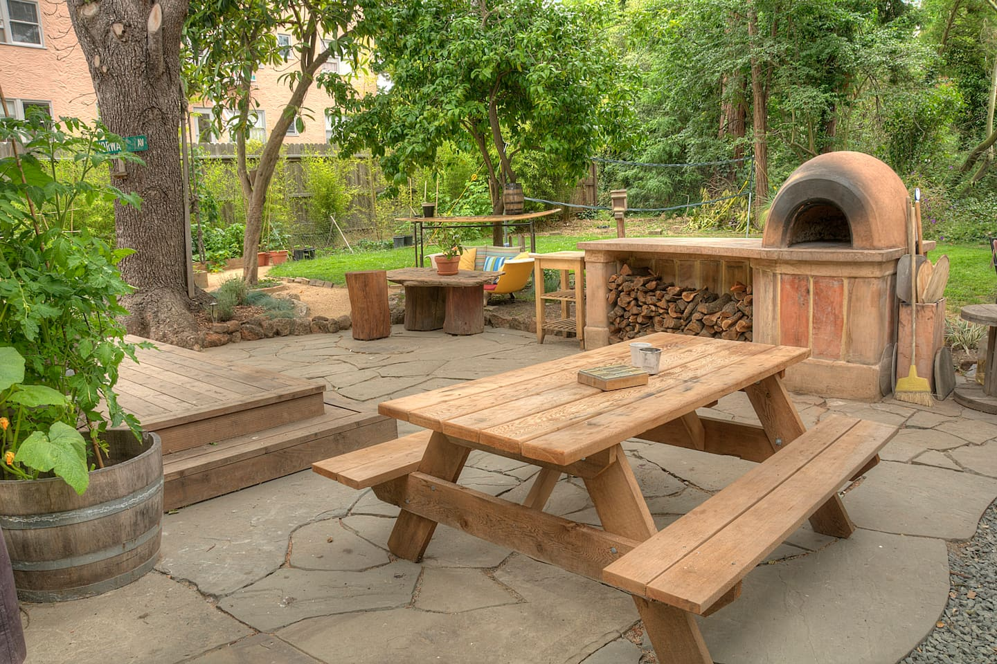 Patio and yard with cob pizza oven, bbq and lots of room to hang out.