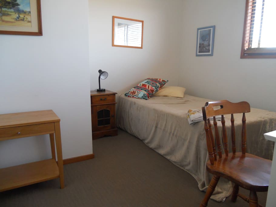 King single bed. Has a nice outlook to the poolarea