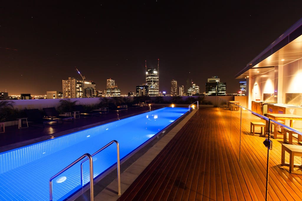 Rooftop Pool in the Building with amazing night views