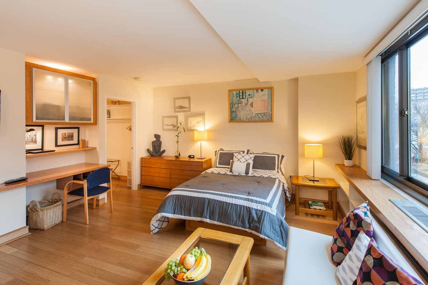 Unit features full-sized bed, gleaming bamboo floors.