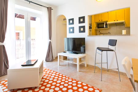 Comfy and homely apartment 100 meters from Cala Mayor beach.  Close to a variety of excellent bars, restaurants and entertainment. Apartment includes a big living-room with kitchen, bedroom with double bed en suite and WiFi internet and A/C