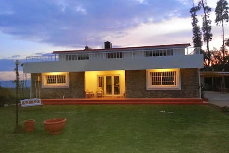 Are you looking to have a relaxing and peaceful holiday in Ooty, then this is the right place. Away from all the crowded areas of Ooty, a serene spacious 4000 sft villa,on mountain top, 360 degree view, with huge lawn,every room connecting to nature, serenity and tranquility in abundance .