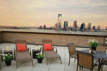Battery Park directly on the water and esplanade  luxury One bedroom doorman building,fully loaded, see thru kitchen, top floor, one full bath with roof deck and full gym. fully furnished with 65 inch flat screen tv's. Walking distance to all attract