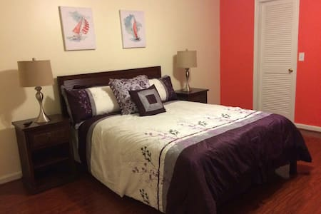 Beautiful master bedroom with bath queen size bed hardwood floors walk in closet cable TV wifi premium channels located Palm Beach Gardens