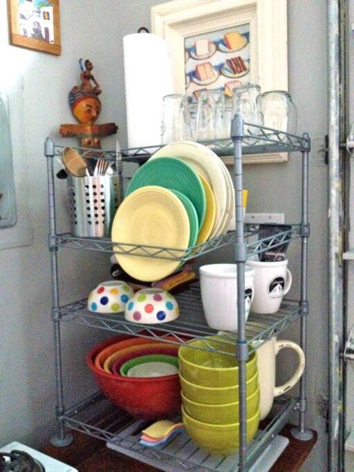 lots of plates, bowls, cookware etc..