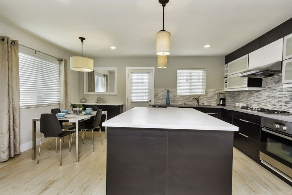 Updated decor and sleek center island for dining and entertaining