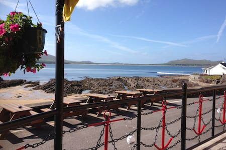 Room 3 consists of four single beds, toilet and shower. There are 5 other rooms in the Lodge and a Self-Catering kitchen.  Tigh T.P.'s Pub is right next door to enjoy a breath-taking view,  fresh seafood, pints and great craic!