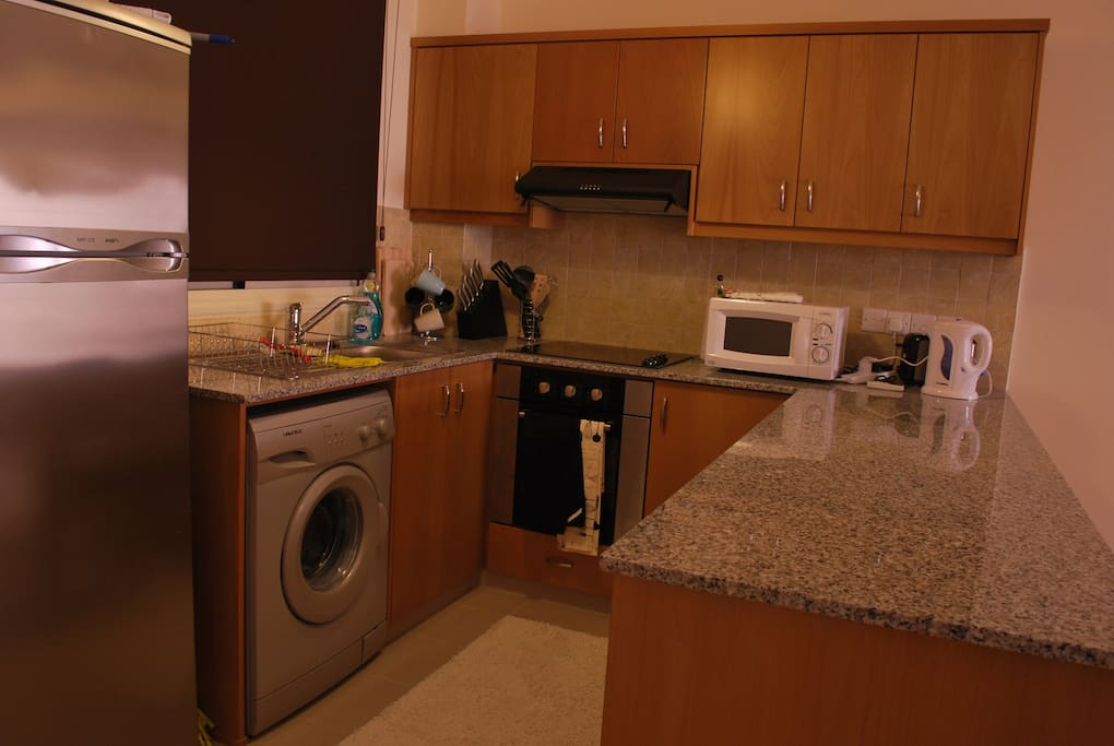 Fully equipped kitchen with all the comforts you need for a great stay.