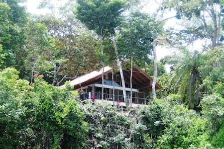 Living in little wilderness with comfort. A house with a spacious living room with doors all over to the terrace. Surrounded by nature. Spectacular view over the National Marine Park 'Gulf of Chiriqui'. Birds and monkeys surrounding this house daily.