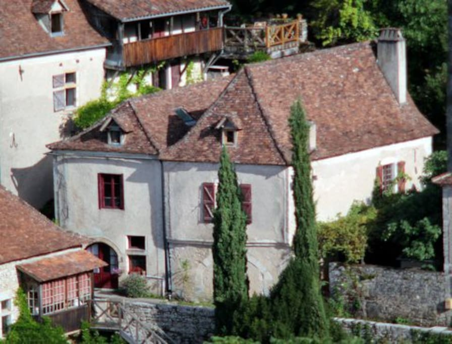 Maison d'Etre is two houses combined with a garden behind an ancient stone wall on the right