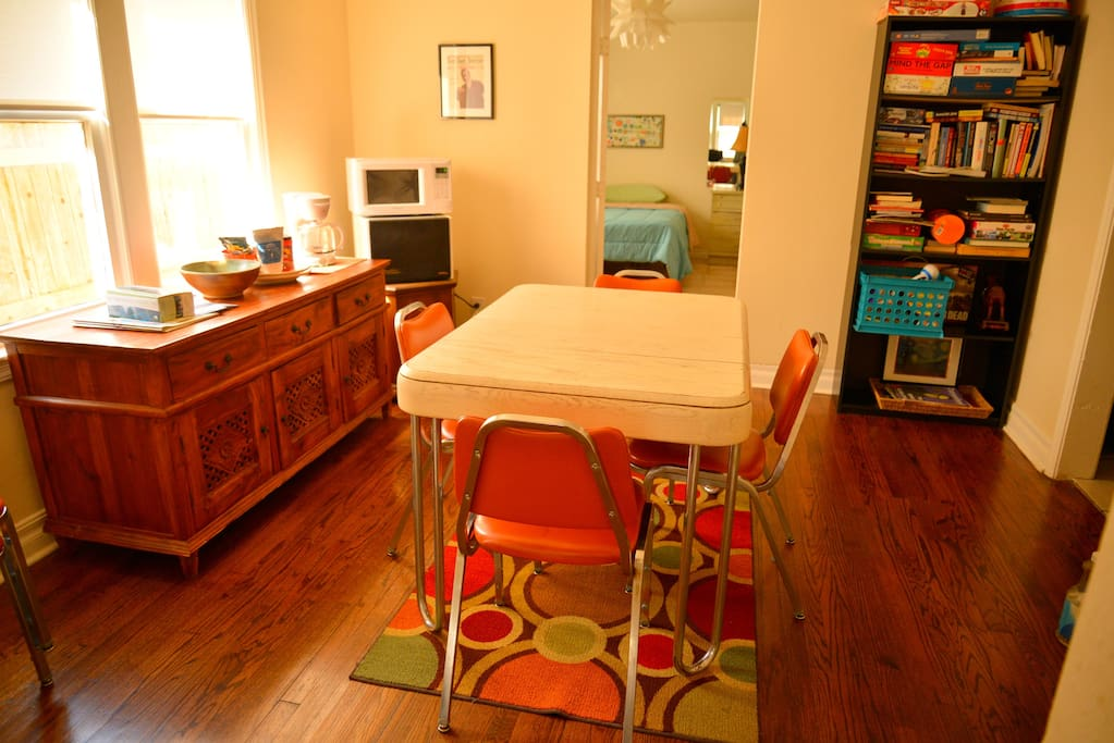 Breakfast nook with coffee maker, microwave, dehydrator and shared library.