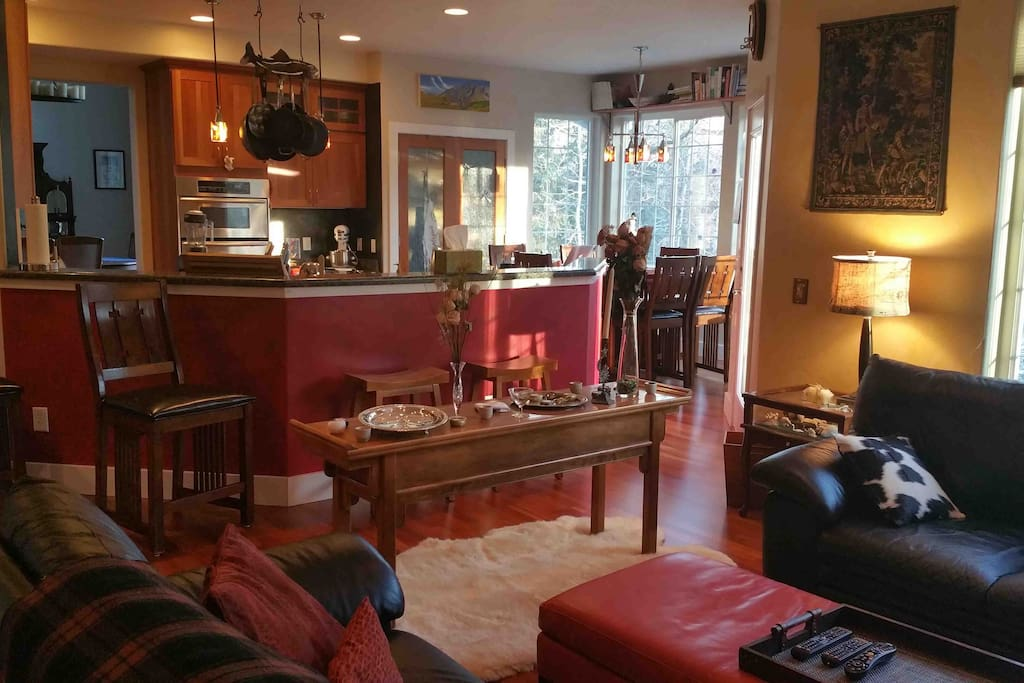 Family room with second fireplace and TV just off the kitchen