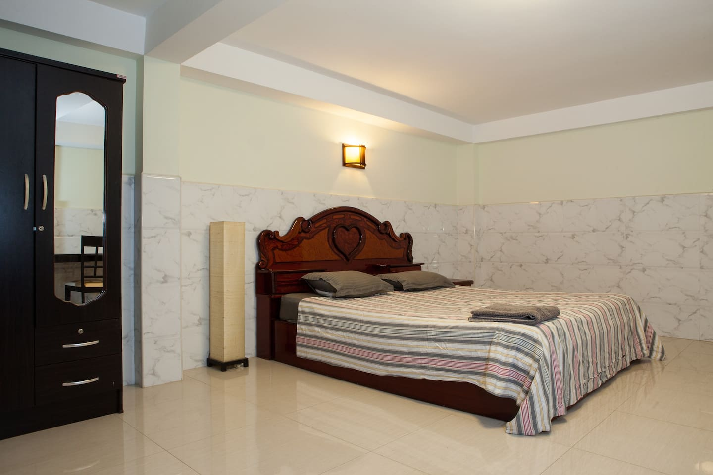 B. Large room, own shower and WC