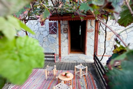 Taş Mahal is a cosy house, decorated in traditional Turkish style,  only five minutes drive from the sea. It is surrounded by orange groves and forests, with breathtaking views of Tahtahli Mountain from the terrace.