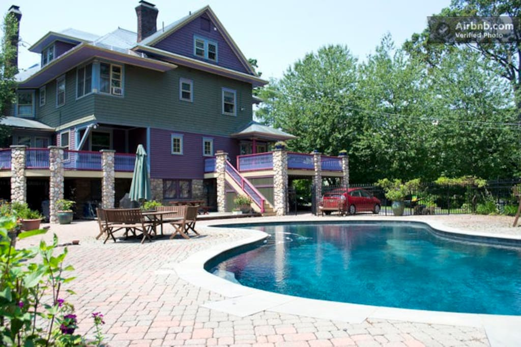 Back of house showing pool, porches and pool deck.