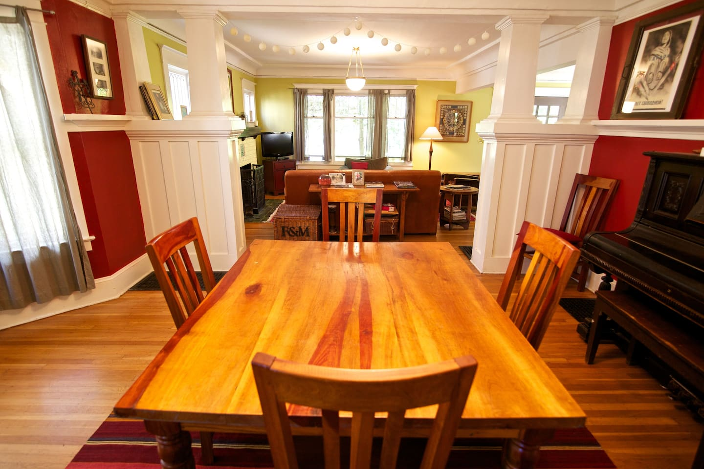 Dining room with salvaged wood table and piano