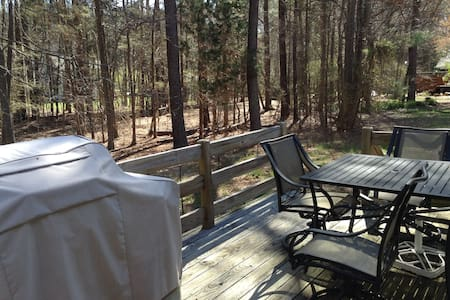 Our cozy and spacious house surrounded by giant oak trees has a true Southern feel!  Available(1) bedroom, private bathroom comfortably  fits 2 plus an additional room is available for a small fee. Enjoy a gourmet kitchen or eat out on the deck.