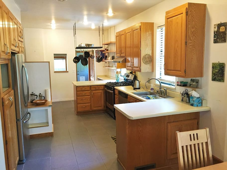 Large open and well stocked kitchen.
