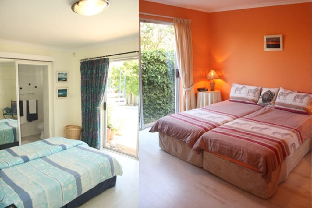 Two of the five bedrooms with sliding doors to the garden or pool area with ensuite bathrooms