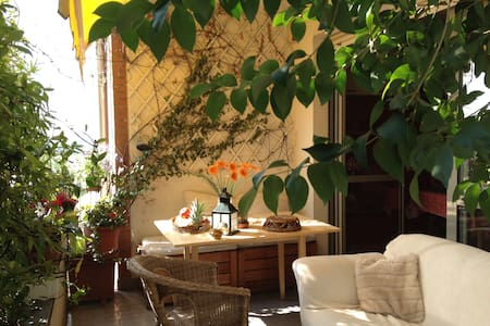 lovers of design and plants, used to friendly-couchsurf: our flat has  terraces, a big kitchen and  open space.  relaxing rooms have double bed, wi-fi and air conditioned. Expo-Fair are 4 minutes by train (one stop). (ask us how to buy cheap tickets)