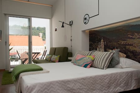 We have 2 rooms overlooking the street + 2 rooms overlooking the mountain. All have en-suite bathroom, TV, air-conditioning and free wireless internet. Breakfast is included in the rate. Possibility of extra bed.