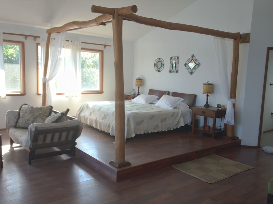 Spectacular master bedroom king sized platform bed with views of the ocean!