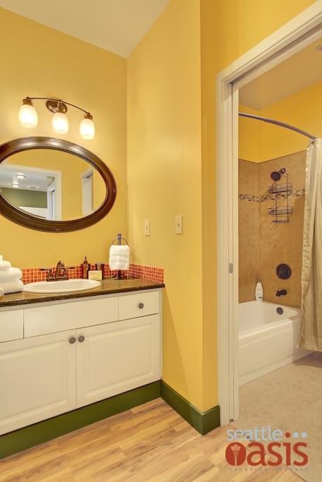 Freshen up in front of the vanity! All the bathroom basics will be here waiting for you! Even a hairdryer.
