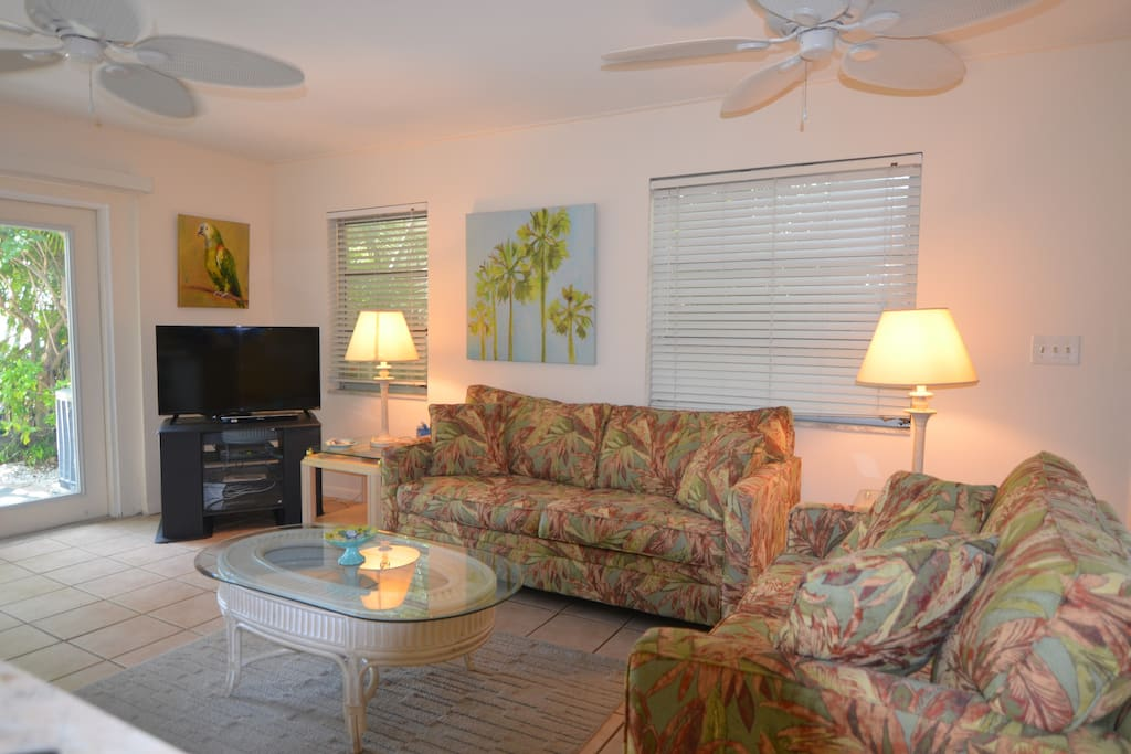 Full size living area with Sleeper Sofa and loveseat