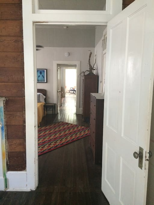 Shotgun style front to back- parlor, shared bedroom, hall/bathroom, semi-private room, kitchen.