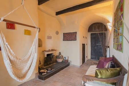 This characteristic apartment is located on the ground floor and is made up of a large entry hall with fireplace, lounge with open-plan kitchen, double bedroom, a single room and bathroom.