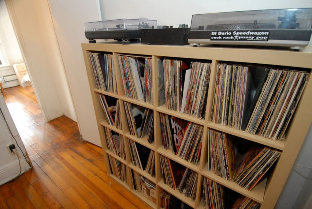 My vinyl record collection and turntables.