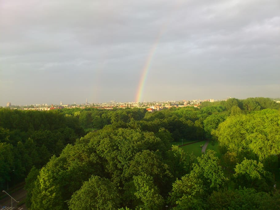The view of Rembrandtpark with rainbow in the summer