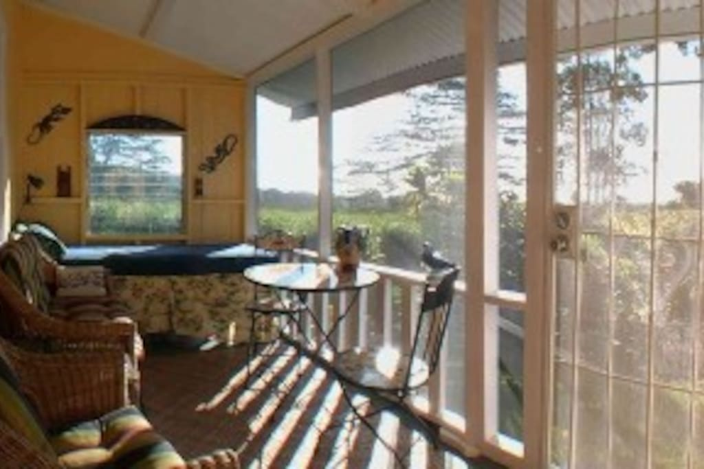 Lanai sun porch in back of main house. Perfect for morning sunrise coffee or evening sunset tea.  A great place to read a book or write.