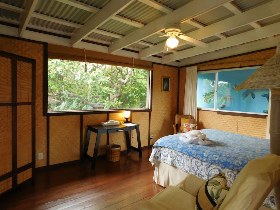 A spacious 11ft by 15ft room with a garden view.