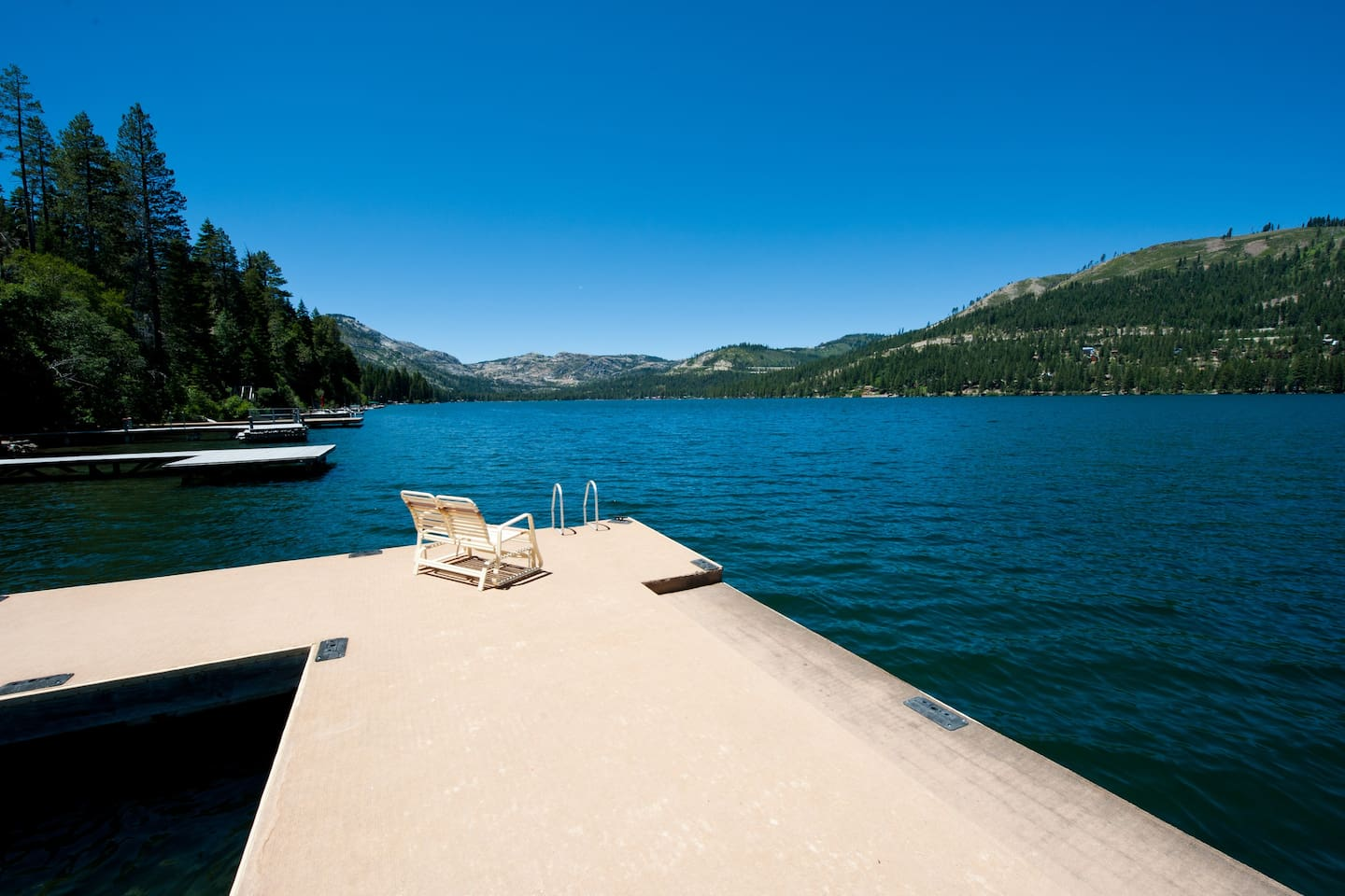 The view from the lake on the private dock with a swim ladder and swim step.