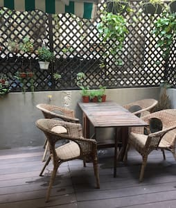 Two mins from MTR train.   Terrace for beers.   Close to great restaurants, supermarket, bottle shop.  Double bed Bright and newly renovated.  Unlimited wifi.  Basic outside kitchen facilities (on terrace).  First floor walkup building. Long term rental available. Please enquire.