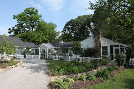 The Greenskeeper House - accommodates up to 10 inside and 40 outside.  Enjoy the ultimate zen today! Just minutes from i-71 and 20 min from the airport. We have 3 spare bedrooms and a cabin. Each room must be booked separately. Have an event? Inquire.