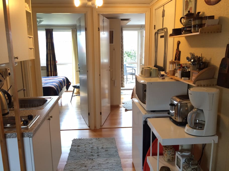 The kitchenette and the two bedrooms.