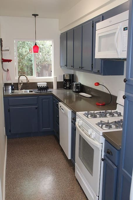 Brand new kitchen with granite counter tops, breakfast bar, all new appliances including dishwasher and washer/dryer.