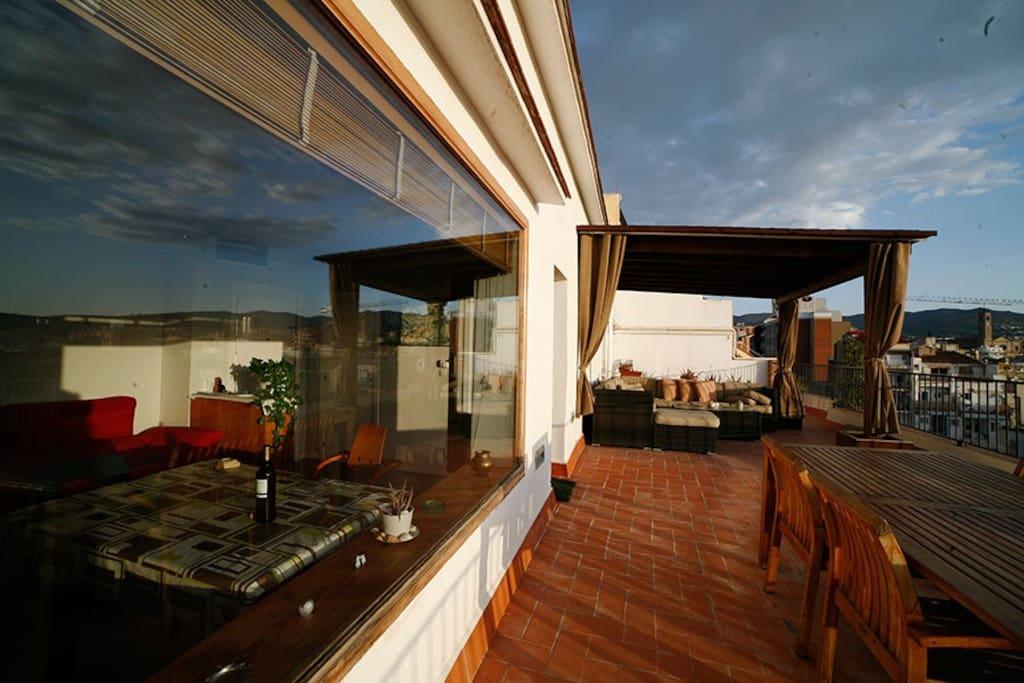 Panoramic Living Space Window overlooking Chillout Area with Mediterranean kkies